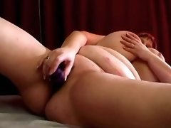 Fat woman plays with massive boobs