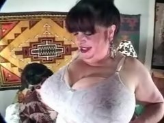 Woman oiling enormous huge melons