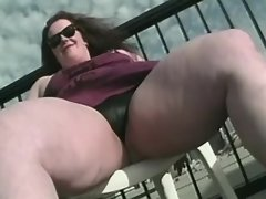 Flabby woman presents her fat pussy