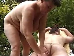 Chubby mature seduces man in nature