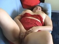Chubby girl plays with her pussy